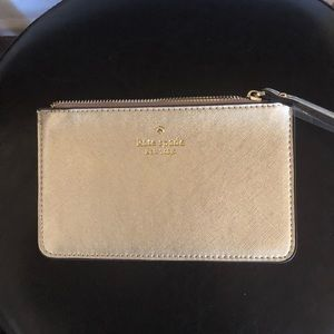NEW. Kate Spade wristlet gold comes packeged🌲🎁